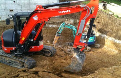 Vargo digging pool demolition with tufo